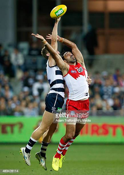 Adam Goodes of the Swans and Jake Kolodjashnij of the Cats compete for the ball during the 2015 AFL round 19 match between the Geelong Cats and the...