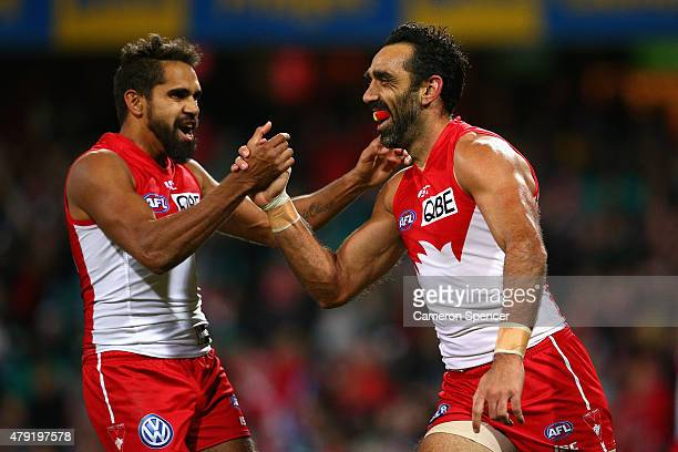 Adam Goodes of the Swans celebrates kicking a goal with team mate Lewis Jetta during the round 14 AFL match between the Sydney Swans and the Port...