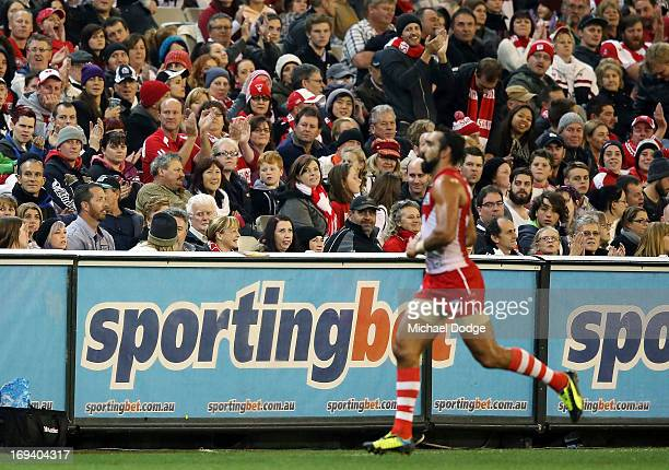 Adam Goodes of the Swans comes off the ground and is clapped by fans during the round nine AFL match between the Collingwood Magpies and the Sydney...