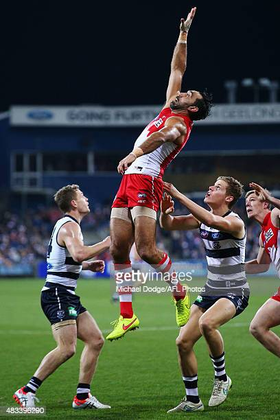 Adam Goodes of the Swans competes for the ball against Joel Selwood of the Cats and Jake Kolodjashnij during the round 19 AFL match between the...