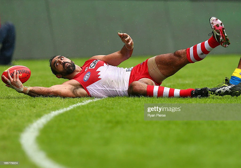 <a gi-track='captionPersonalityLinkClicked' href=/galleries/search?phrase=Adam+Goodes&family=editorial&specificpeople=206473 ng-click='$event.stopPropagation()'>Adam Goodes</a> of the Swans controls the ball during the round two AFL match between the Sydney Swans and the Gold Coast Suns at SCG on April 6, 2013 in Sydney, Australia.