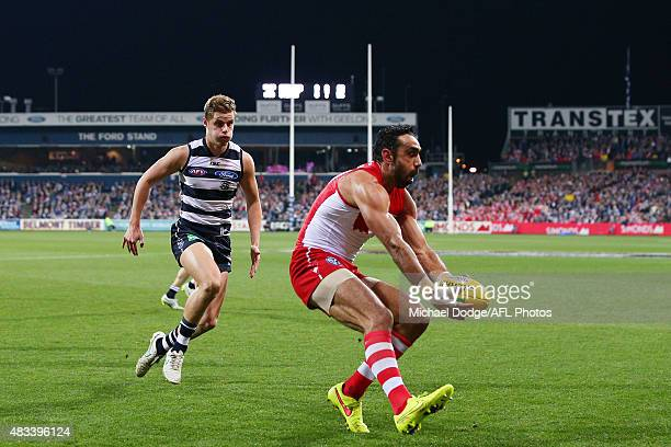 Adam Goodes of the Swans gathers the ball from Jake Kolodjashnij of the Cats during the round 19 AFL match between the Geelong Cats and the Sydney...