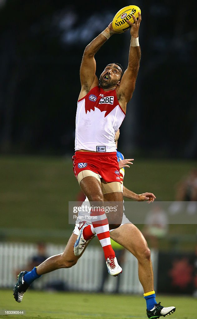 <a gi-track='captionPersonalityLinkClicked' href=/galleries/search?phrase=Adam+Goodes&family=editorial&specificpeople=206473 ng-click='$event.stopPropagation()'>Adam Goodes</a> of the Swans marks during the round three NAB Cup AFL match between the Sydney Swans and the Gold Coast Suns at Blacktown International Sportspark on March 9, 2013 in Sydney, Australia.