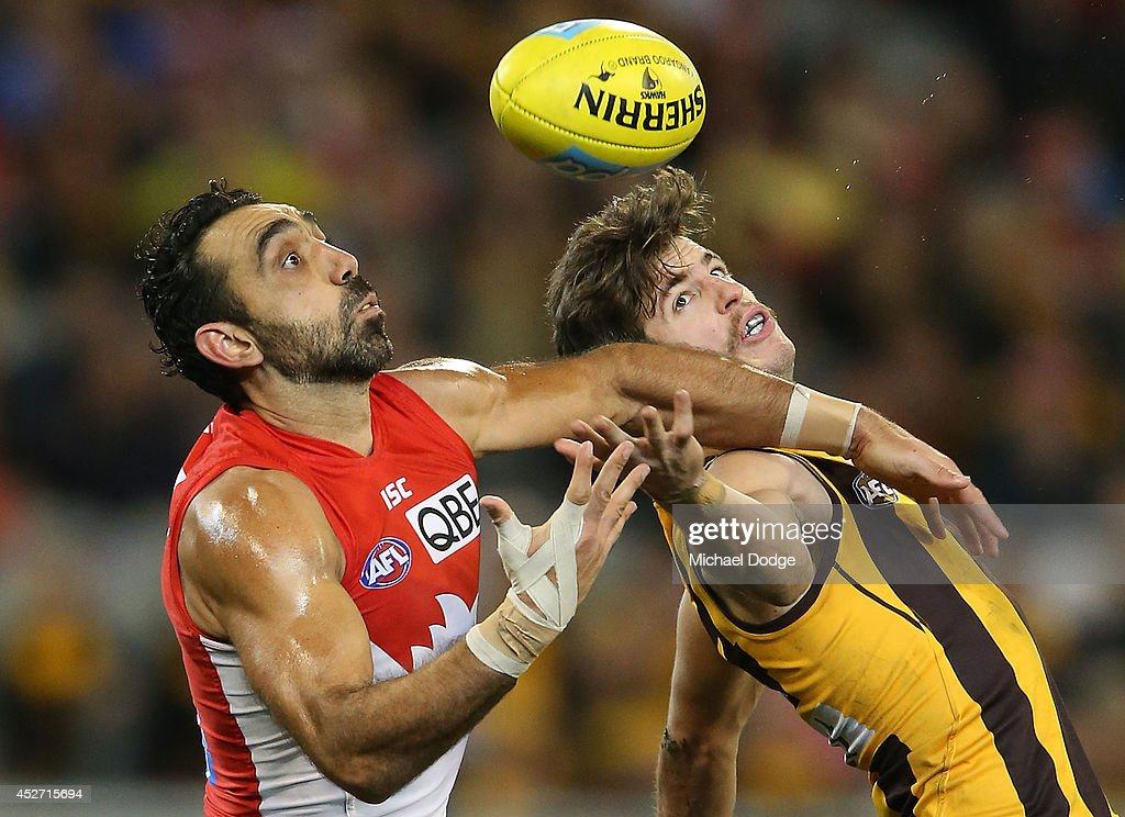 <a gi-track='captionPersonalityLinkClicked' href=/galleries/search?phrase=Adam+Goodes&family=editorial&specificpeople=206473 ng-click='$event.stopPropagation()'>Adam Goodes</a> of the Swans marks the ball against Ben Stratton of the Hawks during the round 18 AFL match between the Hawthorn Hawks and the Sydney Swans at Melbourne Cricket Ground on July 26, 2014 in Melbourne, Australia.