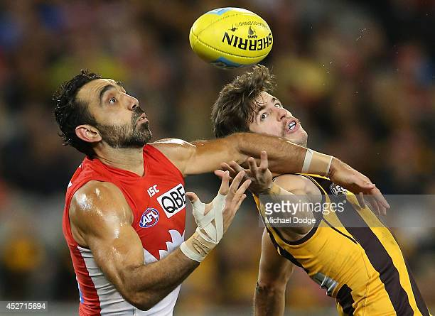 Adam Goodes of the Swans marks the ball against Ben Stratton of the Hawks during the round 18 AFL match between the Hawthorn Hawks and the Sydney...