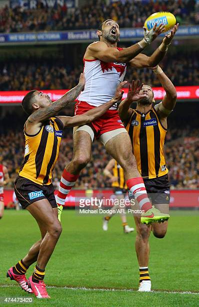 Adam Goodes of the Swans marks the ball against Bradley Hill and Josh Gibson of the Hawks during the round eight AFL match between the Hawthorn Hawks...