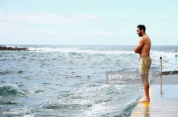 Adam Goodes of the Swans prepares to dive into the ocean during the Sydney Swans recovery sesison at Clovelly Beach on August 31 2014 in Sydney...