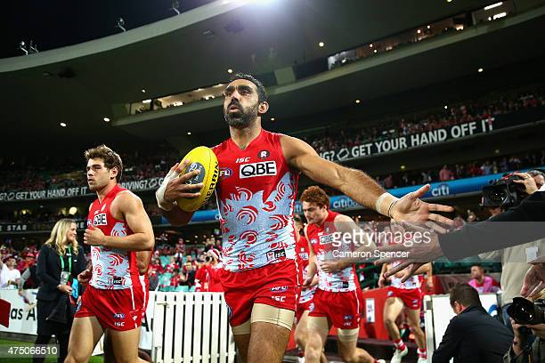 Adam Goodes of the Swans runs onto the field during the round nine AFL match between the Sydney Swans and the Carlton Blues at SCG on May 29 2015 in...