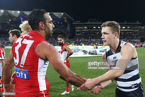 Adam Goodes of the Swans shakes hands with Joel Selwood of the Cats after his defeat during the round 19 AFL match between the Geelong Cats and the...