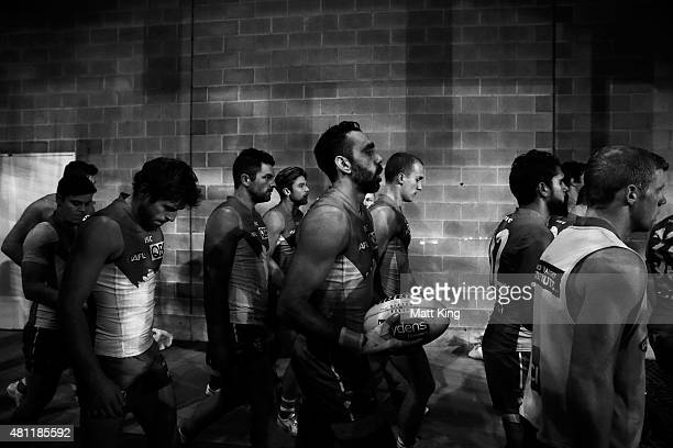 Adam Goodes of the Swans walks out with team mates for the round 16 AFL match between the Sydney Swans and the Hawthorn Hawks at ANZ Stadium on July...