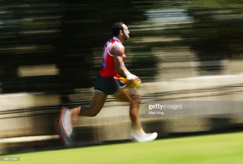 <a gi-track='captionPersonalityLinkClicked' href=/galleries/search?phrase=Adam+Goodes&family=editorial&specificpeople=206473 ng-click='$event.stopPropagation()'>Adam Goodes</a> runs with the ball during a Sydney Swans AFL training session at Lakeside Oval on March 5, 2013 in Sydney, Australia.