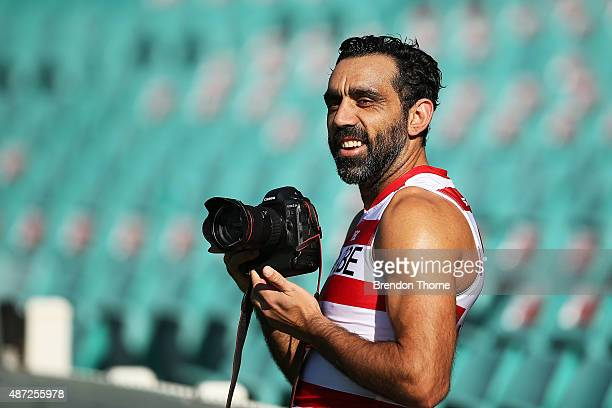 Adam Goodes takes a photo with a professional photographers camera during a Sydney Swans AFL training session at Sydney Cricket Ground on September 8...