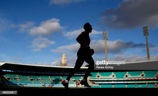 Adam Goodes warms up during a Sydney Swans AFL training session at Sydney Cricket Ground on June 4 2014 in Sydney Australia