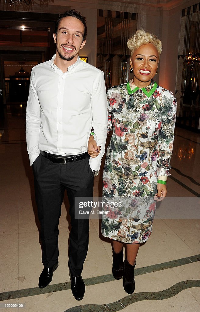 Adam Gouraguine (L) and Musician of the Year winner Emeli Sande pose at the Harper's Bazaar Women of the Year Awards 2012, in association with Estee Lauder, Harrods and Tiffany & Co., at Claridge's Hotel on October 31, 2012 in London, England.