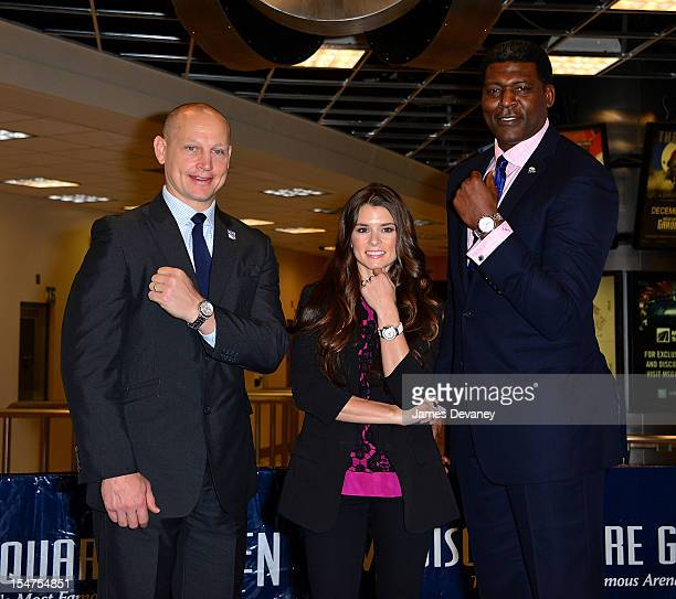Adam Graves Danica Patrick and Larry Johnson attend the unveiling of the new Tissot Swiss Watches Lobby Clocks at Madison Square Garden Box Office on...