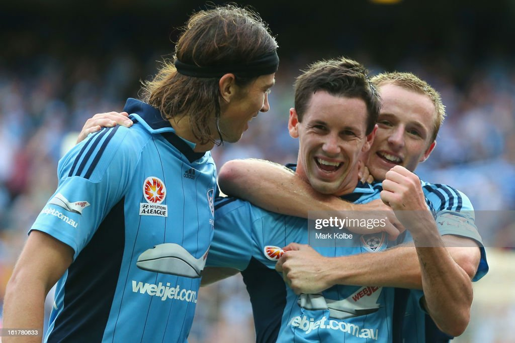 Adam Griffiths (L) and Rhyan Grant (R) of Sydney FC congratulate Blake Powell (C) of Sydney FC as he celebrates scoring a goal during the round 21 A-League match between Sydney FC and Adelaide United at Allianz Stadium on February 16, 2013 in Sydney, Australia.
