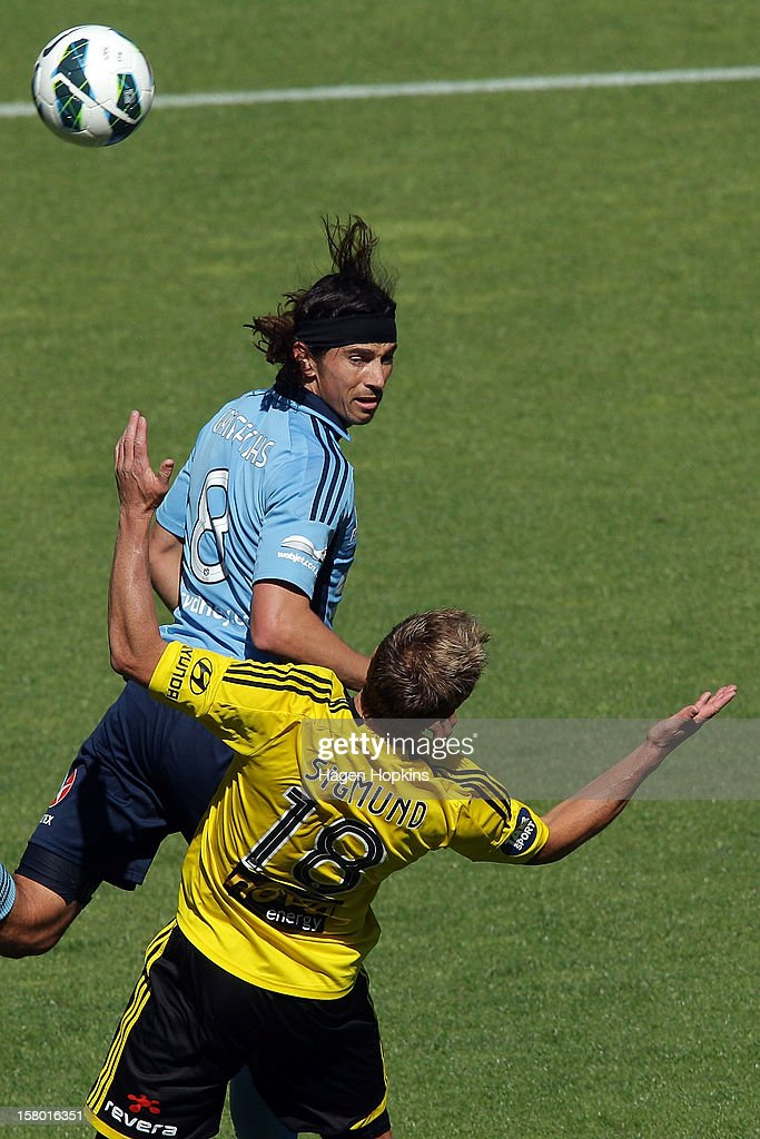Adam Griffiths of Sydney FC heads the ball over Ben Sigmund of the Phoenix during the round 10 A-League match between Wellington Phoenix and Sydney FC at Westpac Stadium on December 9, 2012 in Wellington, New Zealand.