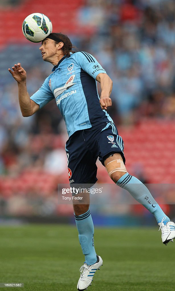 Adam Griffiths of Sydney heads the ball during the round 19 A-League match between the Newcastle Jets and Sydney FC at Hunter Stadium on February 2, 2013 in Newcastle, Australia.