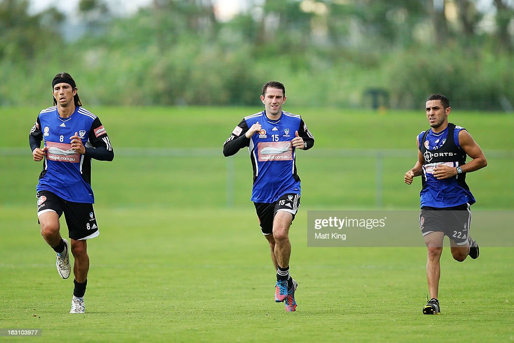 Adam Griffiths, Terry McFlynn and Ali Abbas complete a drill during a Sydney FC A-League training session at Macquarie Uni on March 5, 2013 in Sydney, Australia.
