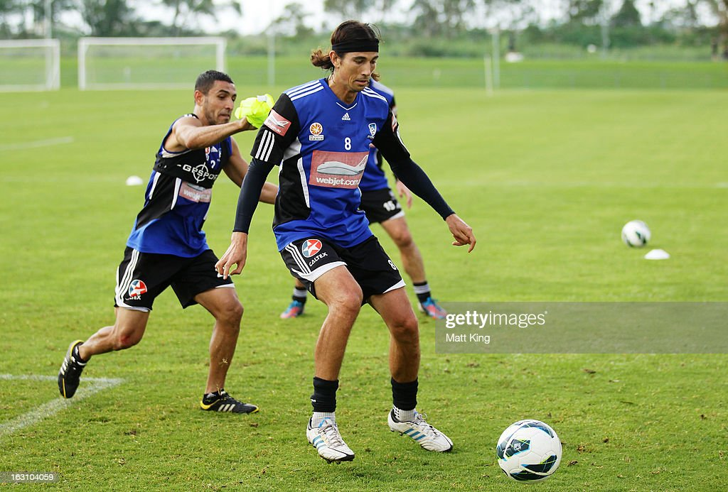 Adam Griffithsis (R) challenged by Ali Abbas (L) during a Sydney FC A-League training session at Macquarie Uni on March 5, 2013 in Sydney, Australia.