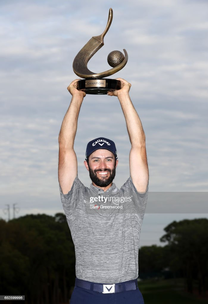 Adam Hadwin of Canada holds the trophy after winning the Valspar Championship during the final round at Innisbrook Resort Copperhead Course on March 12, 2017 in Palm Harbor, Florida. Hadwin won with a score of -14.