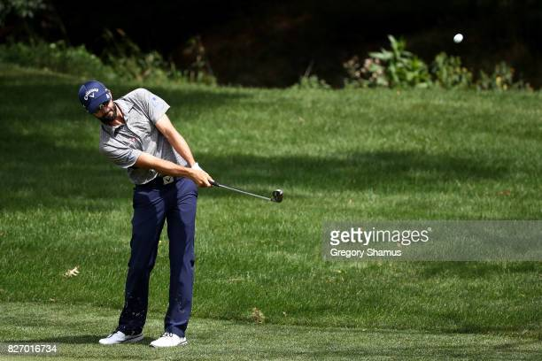 Adam Hadwin of Canada plays a shot on the first fairway during the final round of the World Golf Championships Bridgestone Invitational at Firestone...
