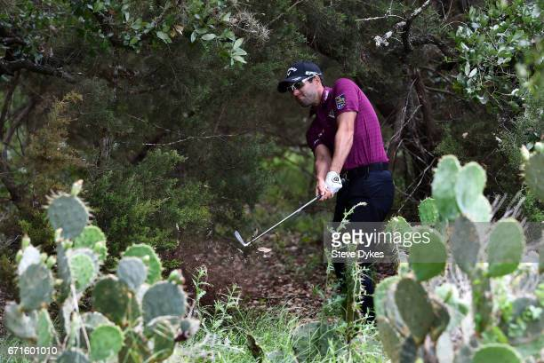 Adam Hadwin of Canada plays his shot out of the rough on the sixth hole during the third round of the Valero Texas Open at TPC San Antonio ATT Oaks...