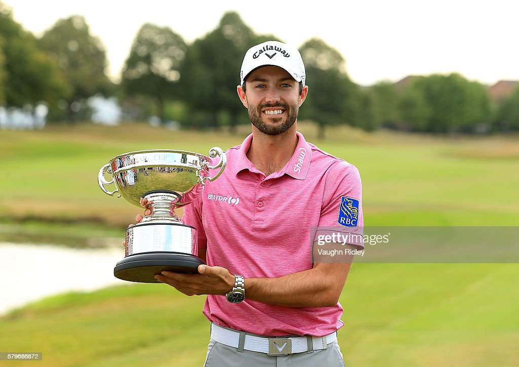 Adam Hadwin of Canada poses with the Rivermead Cup for low Canadian during the final round of the RBC Canadian Open at Glen Abbey Golf Club on July...