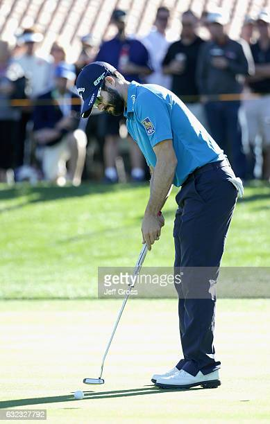 Adam Hadwin of Canada putts for birdie on the 17th hole during the third round of the CareerBuilder Challenge in Partnership with The Clinton...