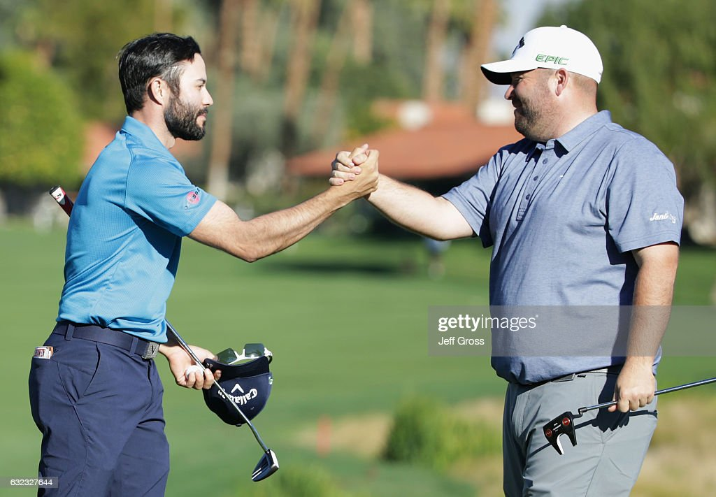 Adam Hadwin of Canada shakes hands with Colt Knost on the 18th hole during the third round of the CareerBuilder Challenge in Partnership with The Clinton Foundation at La Quinta Country Club on January 21, 2017 in La Quinta, California.