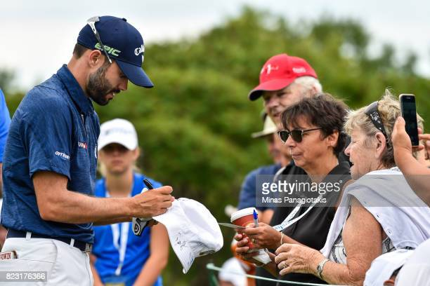 Adam Hadwin of Canada signs autographs on the seventeenth hole during the championship proam of the RBC Canadian Open at Glen Abbey Golf Course on...