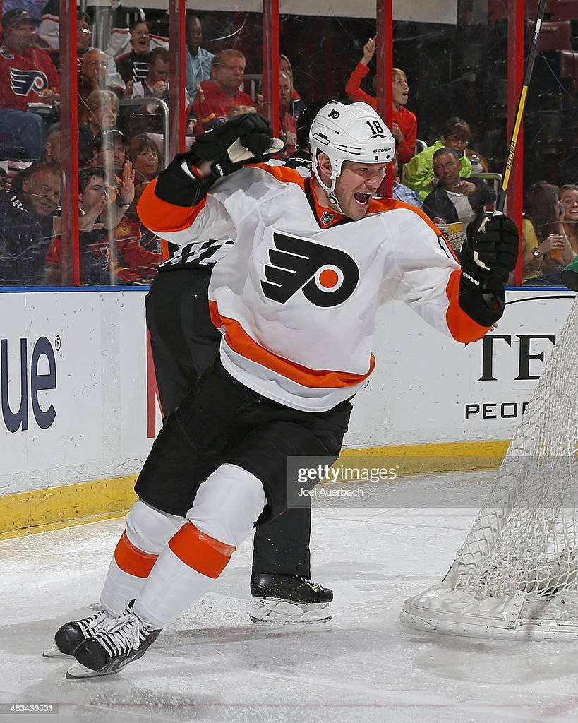 Adam Hall #18 of the Philadelphia Flyers celebrates the second period goal by teammate Vincent Lecavalier #40 (not pictured) against the Florida Panthers at the BB&T Center on April 8, 2014 in Sunrise, Florida.