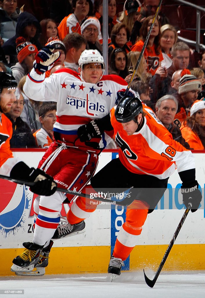 <a gi-track='captionPersonalityLinkClicked' href=/galleries/search?phrase=Adam+Hall&family=editorial&specificpeople=202919 ng-click='$event.stopPropagation()'>Adam Hall</a> #18 of the Philadelphia Flyers checks Alex Ovechkin #8 of the Washington Capitals during the first period of an NHL hockey game at Wells Fargo Center on December 17, 2013 in Philadelphia, Pennsylvania.