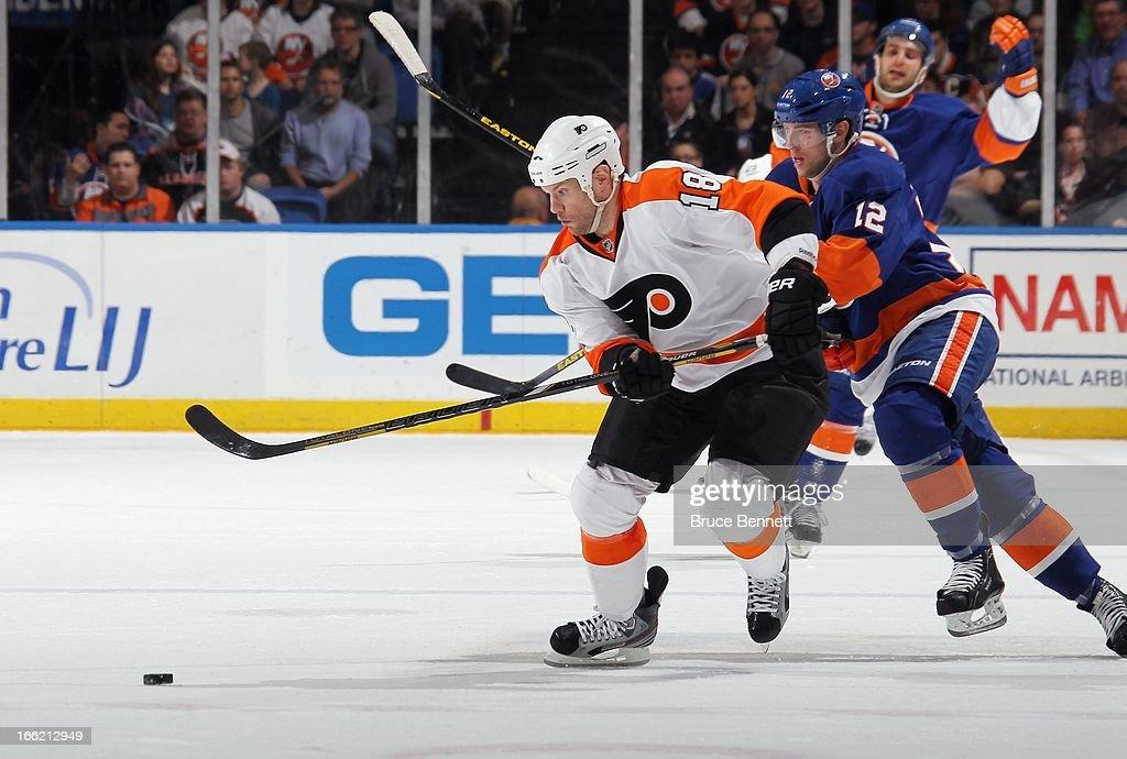 Adam Hall #18 of the Philadelphia Flyers skates against the New York Islanders at the Nassau Veterans Memorial Coliseum on April 9, 2013 in Uniondale, New York. The Islanders defeated the Flyers 4-1.