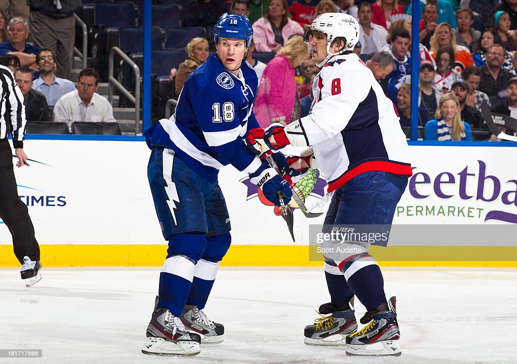 <a gi-track='captionPersonalityLinkClicked' href=/galleries/search?phrase=Adam+Hall&family=editorial&specificpeople=202919 ng-click='$event.stopPropagation()'>Adam Hall</a> #18 of the Tampa Bay Lightning battles for position against Alex Ovechkin #8 of the Washington Capitals during the second period of the game at the Tampa Bay Times Forum on February 14, 2013 in Tampa, Florida.