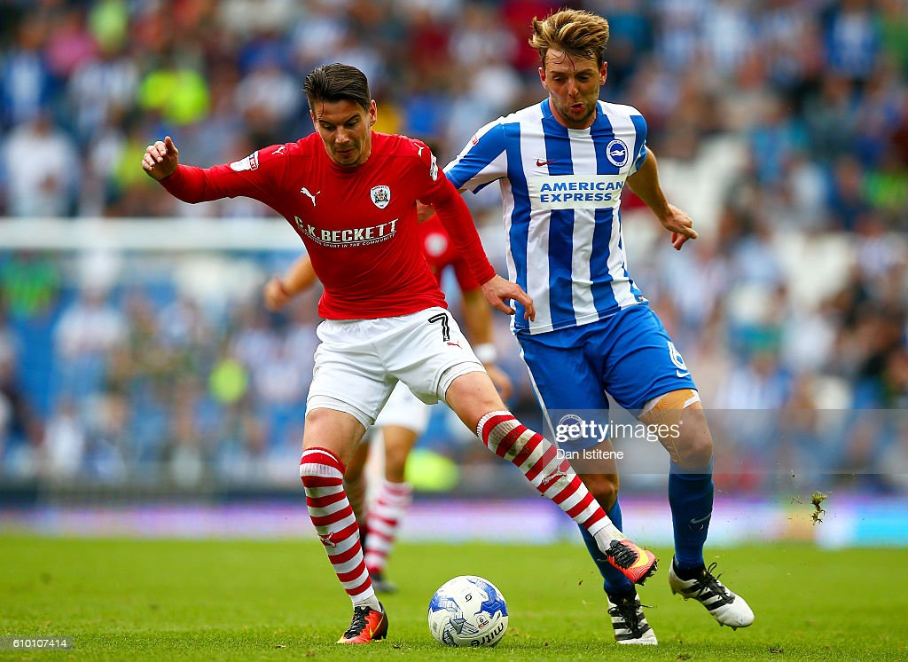 Adam Hammill of Barnsley battles for the ball with Dale Stephens of Brighton & Hove Albionl during the Sky Bet Championship match between Brighton & Hove Albion and Barnsley at Amex Stadium on September 24, 2016 in Brighton, England.