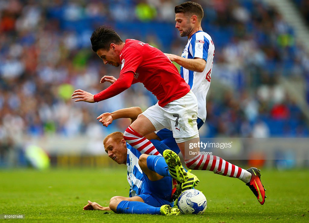 Adam Hammill of Barnsley battles for the ball with Steve Sidwell of Brighton & Hove Albion during the Sky Bet Championship match between Brighton & Hove Albion and Barnsley at Amex Stadium on September 24, 2016 in Brighton, England.