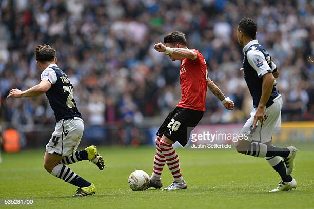 Adam Hammill of Barnsley FC scores the 2nd goal during the Sky Bet League One Play Off Final between Barnsley and Millwall at Wembley Stadium on May...