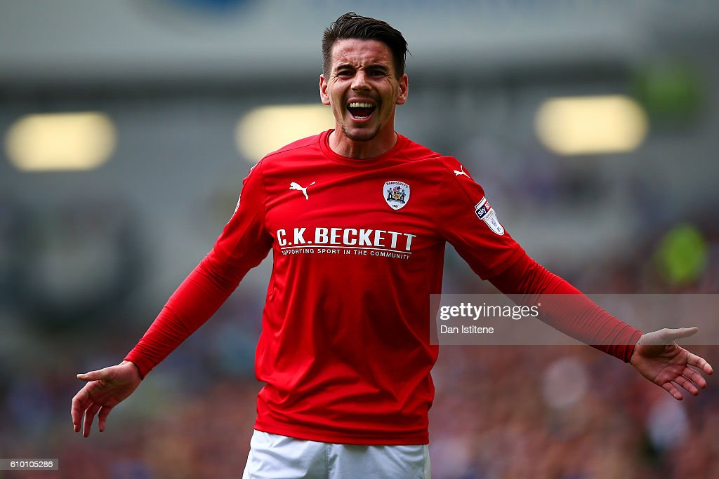 Adam Hammill of Barnsley reacts during the Sky Bet Championship match between Brighton & Hove Albion and Barnsley at Amex Stadium on September 24, 2016 in Brighton, England.