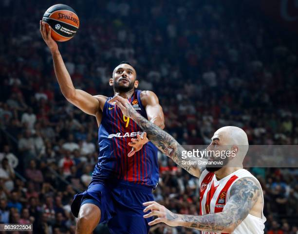 Adam Hanga of Barcelona in action against Pero Antic of Crvena Zvezda during the 2017/2018 Turkish Airlines EuroLeague Regular Season game between...