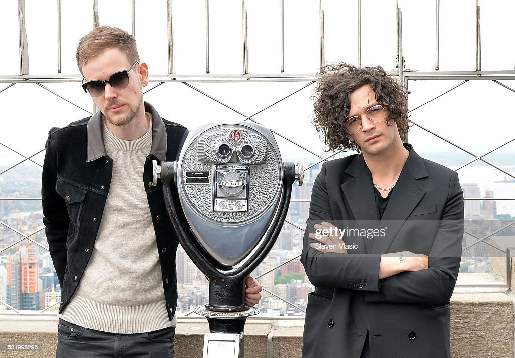 Adam Hann (L) and Matty Healy of The 1975 visit The Empire State Building on May 17, 2016 in New York City.
