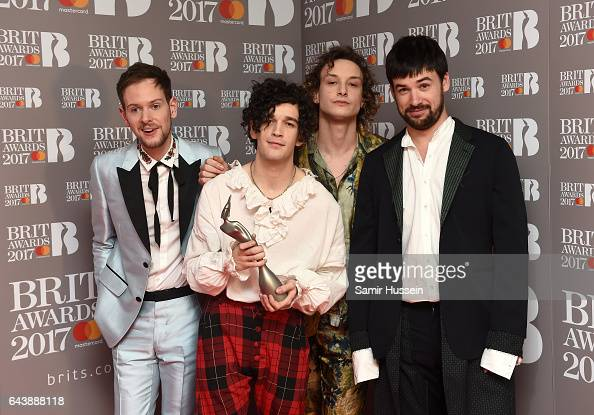Adam Hann Matthew Healy George Daniel and Ross MacDonald of The 1975 pose with their award for Best British group in the winner's room during The...