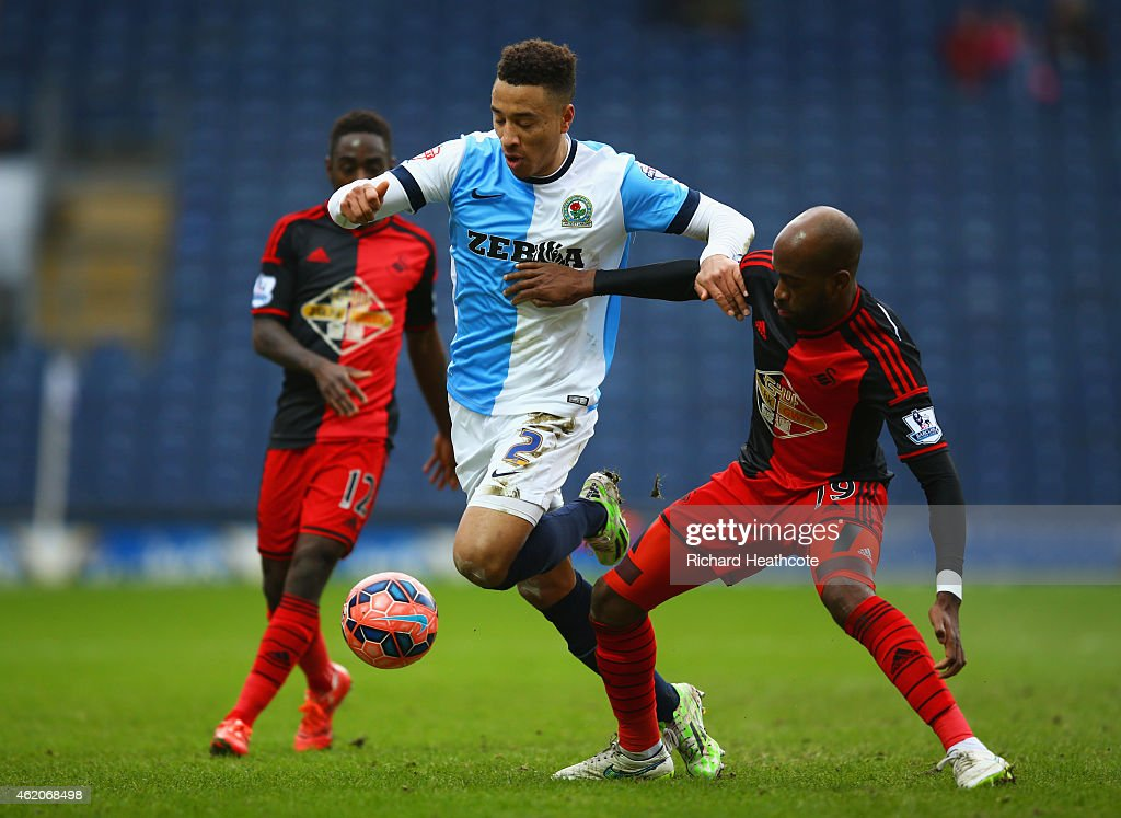Adam Henley of Blackburn Rovers takes on <a gi-track='captionPersonalityLinkClicked' href=/galleries/search?phrase=Dwight+Tiendalli&family=editorial&specificpeople=600413 ng-click='$event.stopPropagation()'>Dwight Tiendalli</a> of Swansea City during the FA Cup Fourth Round match between Blackburn Rovers and Swansea City at Ewood park on January 24, 2015 in Blackburn, England.