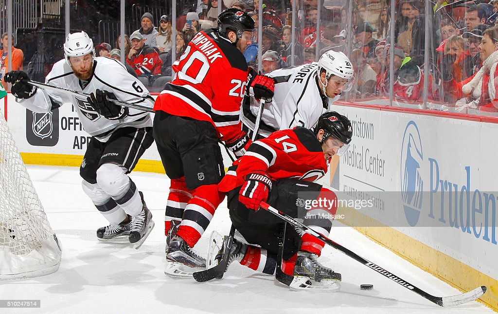 <a gi-track='captionPersonalityLinkClicked' href=/galleries/search?phrase=Adam+Henrique&family=editorial&specificpeople=4043225 ng-click='$event.stopPropagation()'>Adam Henrique</a> #14 and <a gi-track='captionPersonalityLinkClicked' href=/galleries/search?phrase=Lee+Stempniak&family=editorial&specificpeople=575240 ng-click='$event.stopPropagation()'>Lee Stempniak</a> #20 of the New Jersey Devils battle for the puck in the second period against <a gi-track='captionPersonalityLinkClicked' href=/galleries/search?phrase=Nick+Shore+-+Joueur+de+hockey+sur+glace+-+Centre&family=editorial&specificpeople=15081722 ng-click='$event.stopPropagation()'>Nick Shore</a> #21 and <a gi-track='captionPersonalityLinkClicked' href=/galleries/search?phrase=Jake+Muzzin&family=editorial&specificpeople=7205557 ng-click='$event.stopPropagation()'>Jake Muzzin</a> #6 of the Los Angeles Kings at the Prudential Center on February 14, 2016 in Newark, New Jersey.