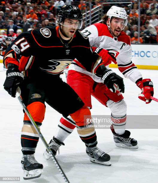 Adam Henrique of the Anaheim Ducks battles for position against Justin Faulk of the Carolina Hurricanes during the game on December 11 2017 at Honda...
