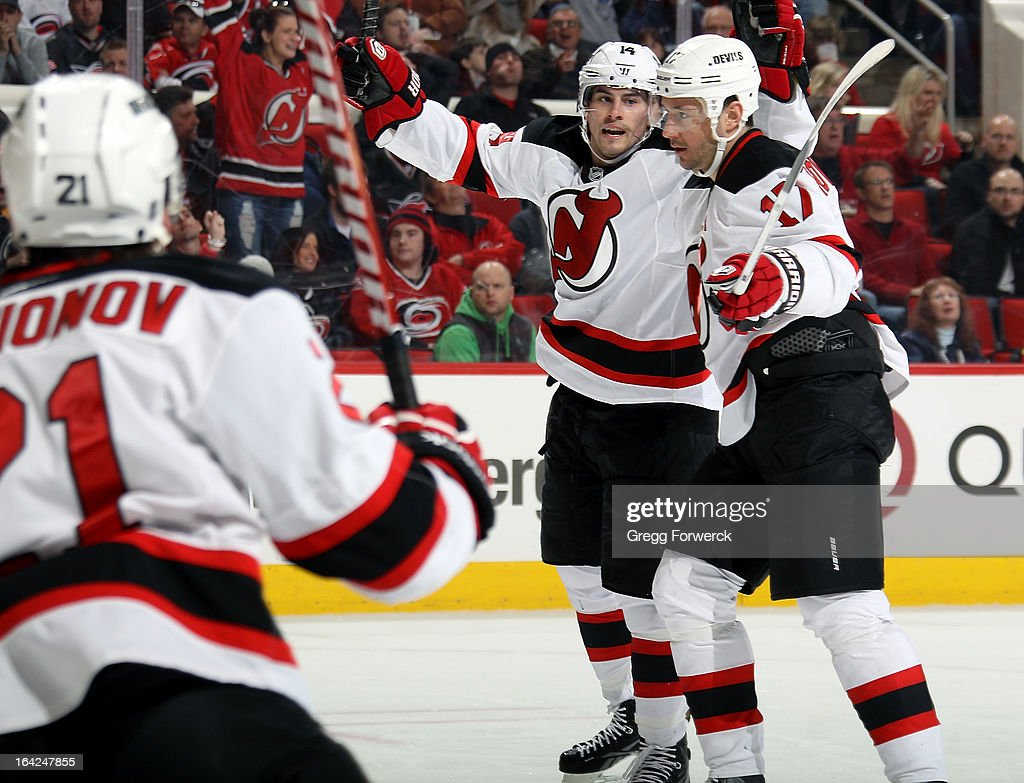 <a gi-track='captionPersonalityLinkClicked' href=/galleries/search?phrase=Adam+Henrique&family=editorial&specificpeople=4043225 ng-click='$event.stopPropagation()'>Adam Henrique</a> #14 of the New Jersey Devils celebrates his second-period goal against the Carolina Hurricanes with <a gi-track='captionPersonalityLinkClicked' href=/galleries/search?phrase=Ilya+Kovalchuk&family=editorial&specificpeople=201796 ng-click='$event.stopPropagation()'>Ilya Kovalchuk</a> #17 during their NHL game at PNC Arena on March 21, 2013 in Raleigh, North Carolina.