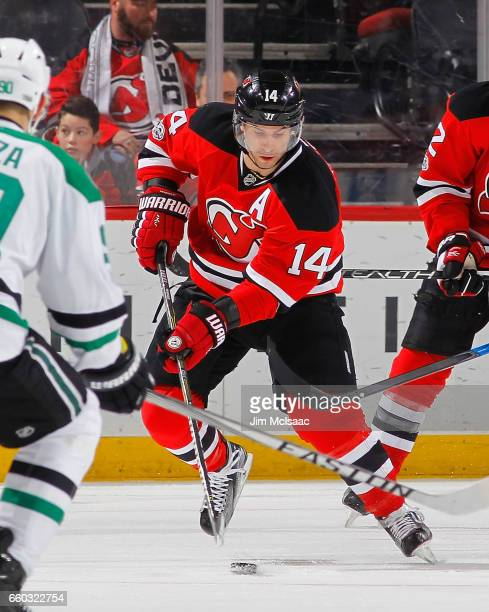 Adam Henrique of the New Jersey Devils in action against the Dallas Stars on March 26 2017 at Prudential Center in Newark New Jersey The Stars...