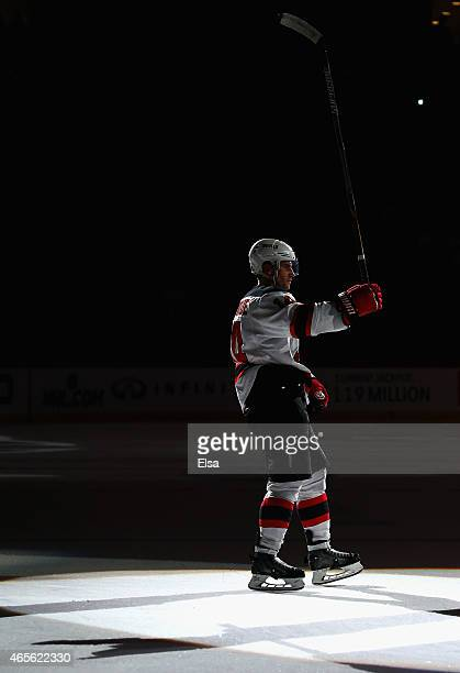 Adam Henrique of the New Jersey Devils salutes the fans after the game against the Philadelphia Flyers on March 8 2015 at the Prudential Center in...