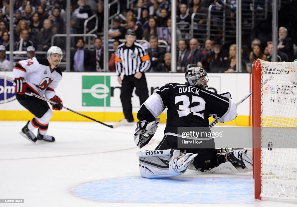 Adam Henrique #14 of the New Jersey Devils scores a goal over goaltender <a gi-track='captionPersonalityLinkClicked' href=/galleries/search?phrase=Jonathan+Quick&family=editorial&specificpeople=2271852 ng-click='$event.stopPropagation()'>Jonathan Quick</a> #32 of the Los Angeles Kings in the third period of Game Four of the 2012 Stanley Cup Final at Staples Center on June 6, 2012 in Los Angeles, California.