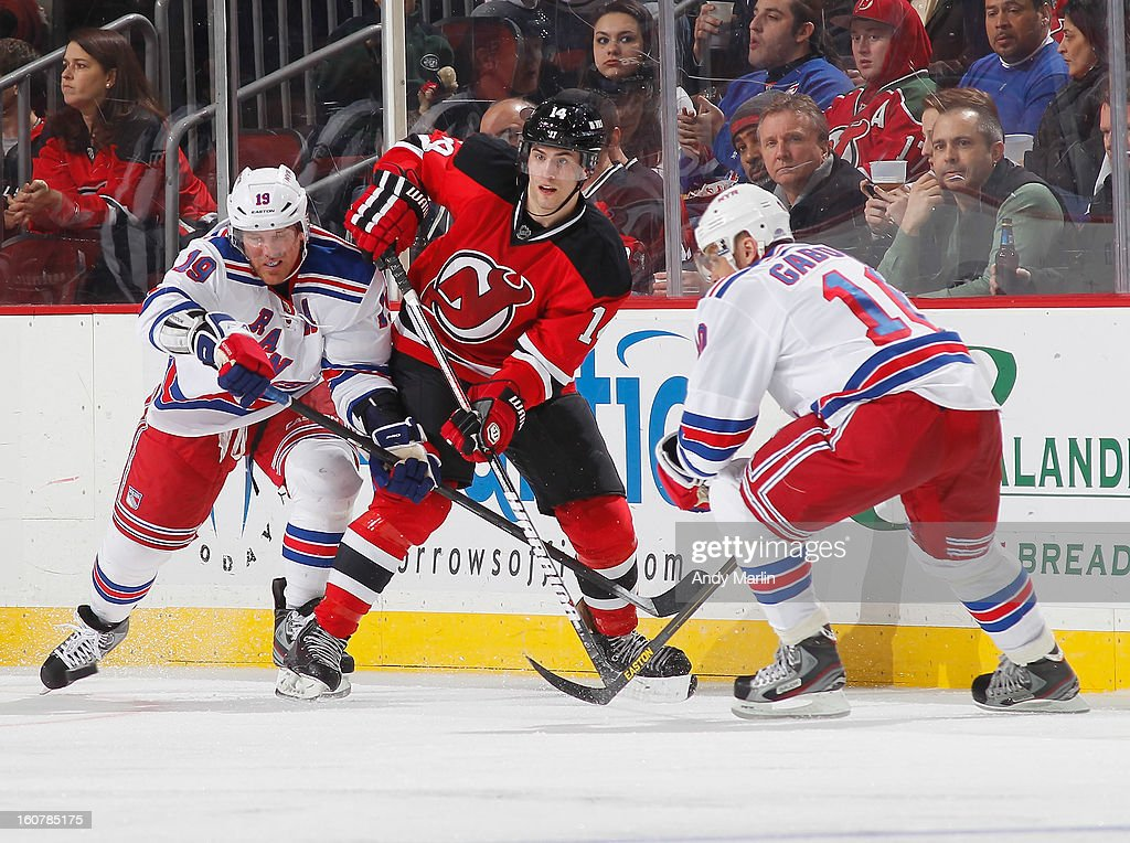 <a gi-track='captionPersonalityLinkClicked' href=/galleries/search?phrase=Adam+Henrique&family=editorial&specificpeople=4043225 ng-click='$event.stopPropagation()'>Adam Henrique</a> #14 of the New Jersey Devils skates against <a gi-track='captionPersonalityLinkClicked' href=/galleries/search?phrase=Brad+Richards&family=editorial&specificpeople=202622 ng-click='$event.stopPropagation()'>Brad Richards</a> #19 and <a gi-track='captionPersonalityLinkClicked' href=/galleries/search?phrase=Marian+Gaborik&family=editorial&specificpeople=202477 ng-click='$event.stopPropagation()'>Marian Gaborik</a> #10 of the New York Rangers at the Prudential Center on February 5, 2013 in Newark, New Jersey. The Devils defeated the Rangers 3-1.